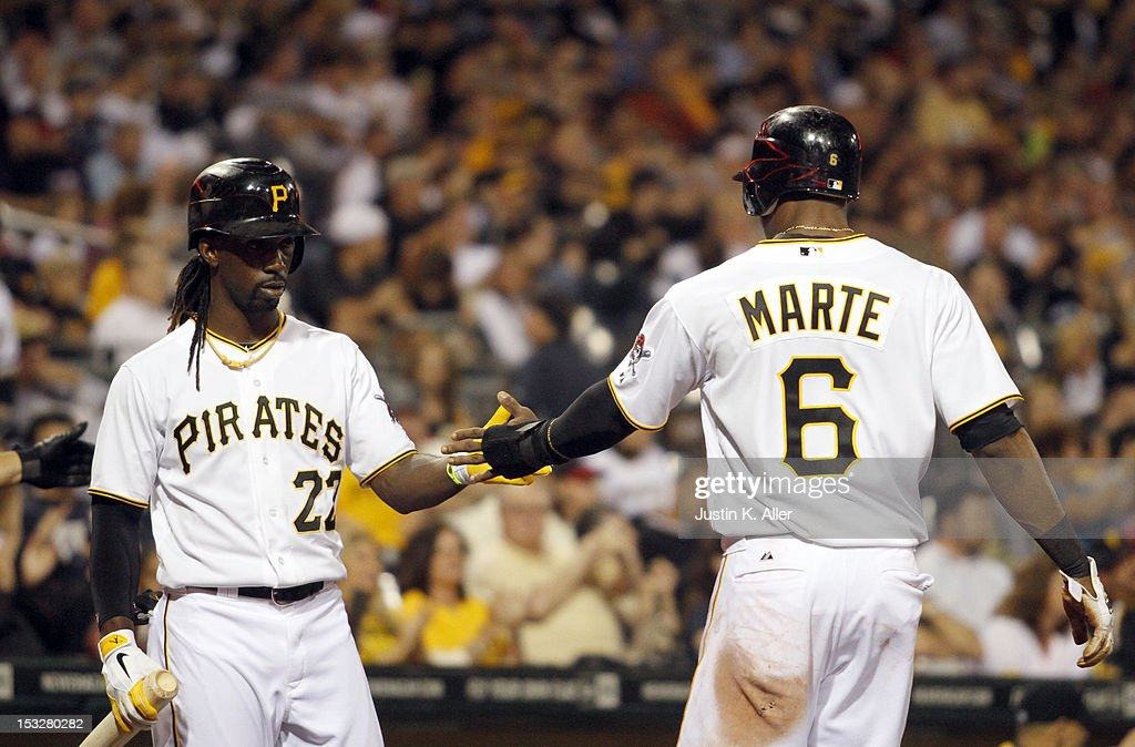 <a gi-track='captionPersonalityLinkClicked' href=/galleries/search?phrase=Starling+Marte&family=editorial&specificpeople=7934200 ng-click='$event.stopPropagation()'>Starling Marte</a> #6 of the Pittsburgh Pirates celebrates after scoring on an RBI double in the fifth inning against the Atlanta Braves during the game on October 2, 2012 at PNC Park in Pittsburgh, Pennsylvania.