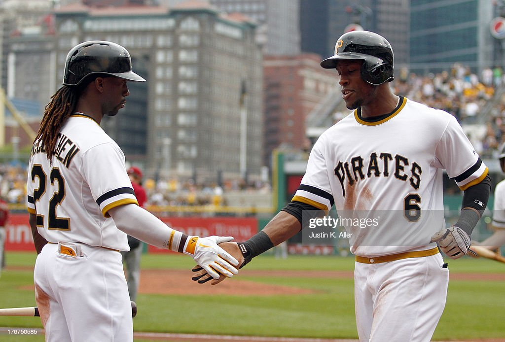 <a gi-track='captionPersonalityLinkClicked' href=/galleries/search?phrase=Starling+Marte&family=editorial&specificpeople=7934200 ng-click='$event.stopPropagation()'>Starling Marte</a> #6 of the Pittsburgh Pirates celebrates after scoring on a RBI double in the third inning against the Arizona Diamondbacks during the game on August 18, 2013 at PNC Park in Pittsburgh, Pennsylvania.