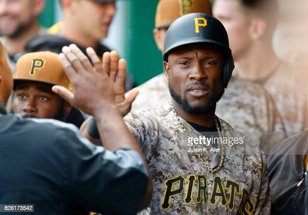 Starling Marte of the Pittsburgh Pirates celebrates after scoring on a RBI single in the first inning against the Cincinnati Reds at PNC Park on...