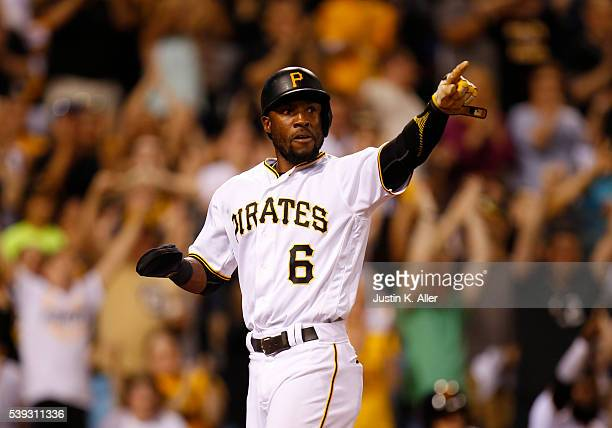 Starling Marte of the Pittsburgh Pirates celebrates while scoring on a RBI single in the ninth inning during the game against the St Louis Cardinals...