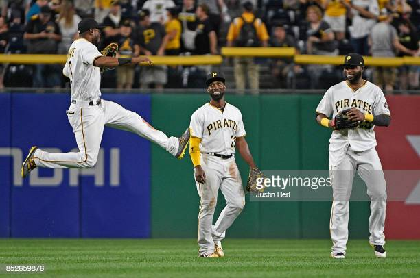 Starling Marte of the Pittsburgh Pirates celebrates with Andrew McCutchen and Gregory Polanco after the final out in the Pittsburgh Pirates 116 win...
