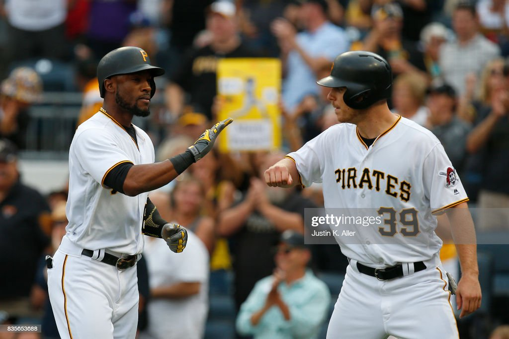 Starling Marte #6 of the Pittsburgh Pirates celebrates with Chad Kuhl #39 after hitting a two run home run in the second inning against the St. Louis Cardinals at PNC Park on August 19, 2017 in Pittsburgh, Pennsylvania.