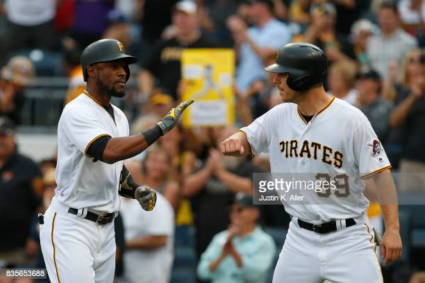 Starling Marte of the Pittsburgh Pirates celebrates with Chad Kuhl after hitting a two run home run in the second inning against the St Louis...