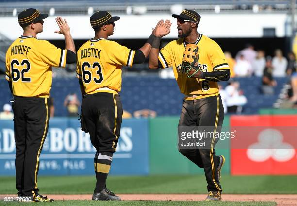 Starling Marte of the Pittsburgh Pirates celebrates with Chris Bostick and Max Moroff after the final out in the Pittsburgh Pirates 41 win over the...