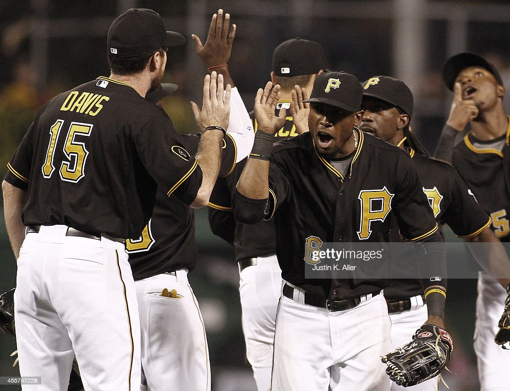 Starling Marte of the Pittsburgh Pirates celebrates with teammates after defeating the Milwaukee Brewers 42 at PNC Park on September 19 2014 in...