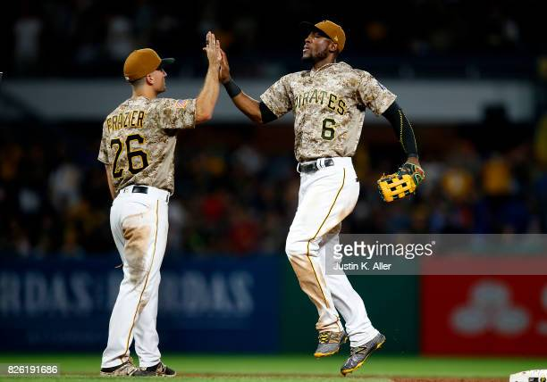 Starling Marte of the Pittsburgh Pirates celebrators with Adam Frazier of the Pittsburgh Pirates after defeating the Cincinnati Reds 60 at PNC Park...