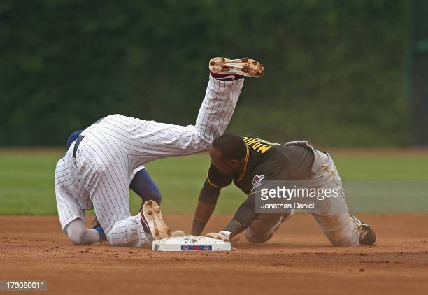 Starling Marte of the Pittsburgh Pirates collides with Starlin Castro of the Chicago Cubs while stealing second base at Wrigley Field on July 6 2013...