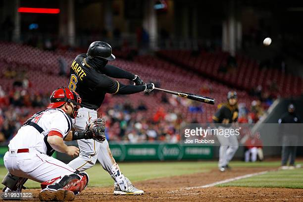 Starling Marte of the Pittsburgh Pirates hits a grand slam in the eighth inning of the game against the Cincinnati Reds at Great American Ball Park...