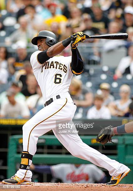 Starling Marte of the Pittsburgh Pirates hits a RBI single in the first inning during the game against the Atlanta Braves at PNC Park on June 27 2015...