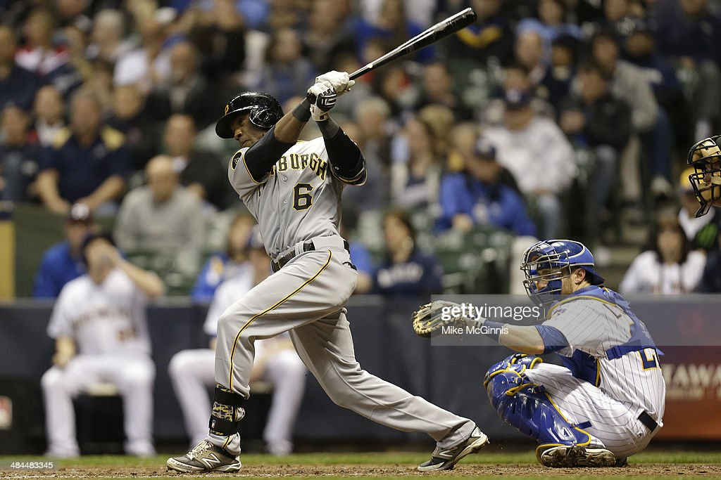 Starling Marte #6 of the Pittsburgh Pirates hits a single in the top of the eighth inning against the Milwaukee Brewers at Miller Park on April 12, 2014 in Milwaukee, Wisconsin.