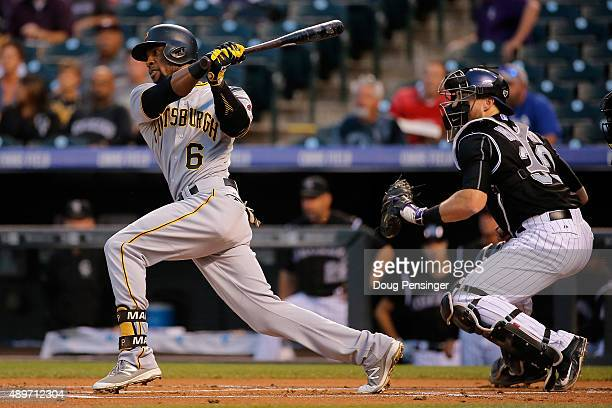 Starling Marte of the Pittsburgh Pirates hits a single off of starting pitcher Christian Bergman of the Colorado Rockies in the first inning at Coors...