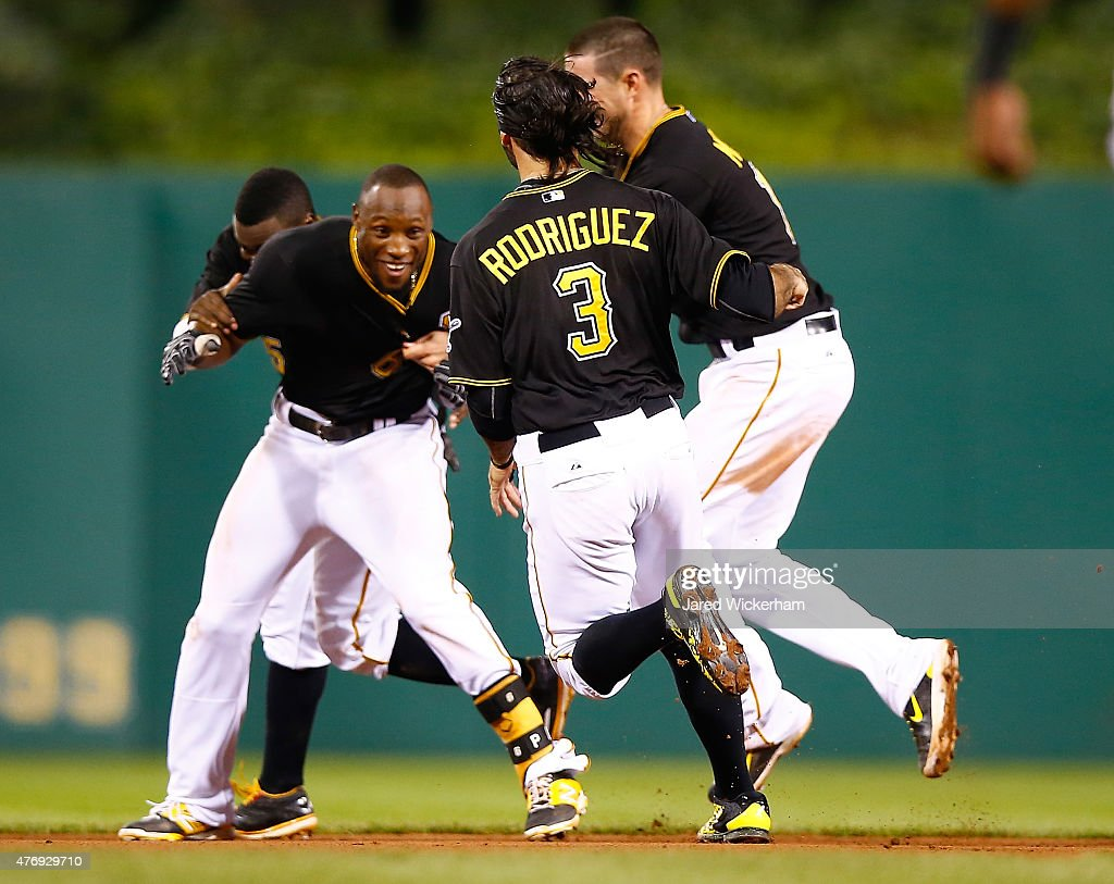 Starling marte photos photos cincinnati reds v pittsburgh pirates - Starling Marte 6 Of The Pittsburgh Pirates Is Mobbed By His Teammates After Hitting The
