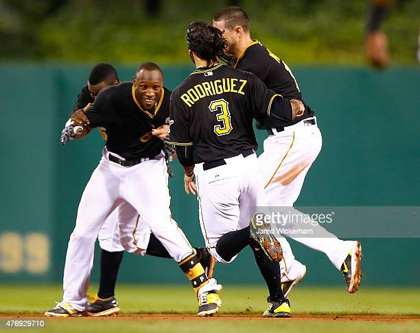 Starling Marte of the Pittsburgh Pirates is mobbed by his teammates after hitting the gamewinning RBI single in the 13th inning against the...
