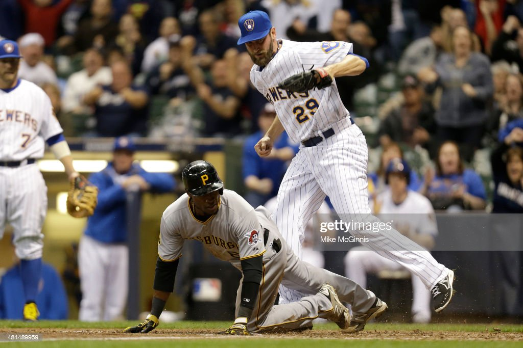 Starling Marte #6 of the Pittsburgh Pirates is tagged out at the plate by Jim Henderson #29 of the Milwaukee Brewers during the top of the eighth inning at Miller Park on April 12, 2014 in Milwaukee, Wisconsin.