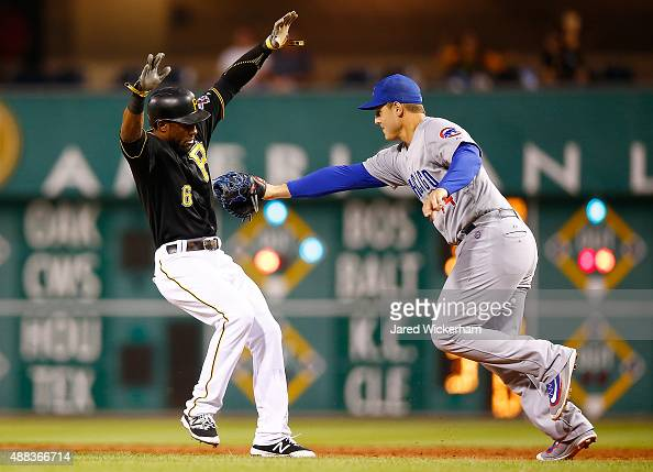 Starling Marte of the Pittsburgh Pirates is tagged out by Anthony Rizzo of the Chicago Cubs after being caught in a rundown at first base in the...