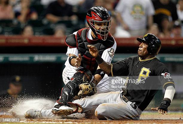 Starling Marte of the Pittsburgh Pirates is tagged out by catcher Carlos Corporan of the Houston Astros trying to score in the fifth inning at Minute...