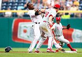 Starling Marte of the Pittsburgh Pirates is tagged out by Chase Utley of the Philadelphia Phillies after attempting to steal second base and having...