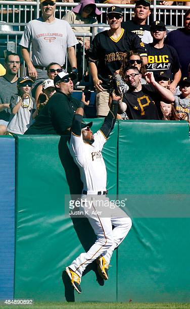 Starling Marte of the Pittsburgh Pirates makes a catch against the wall in the second inning during the game against the San Francisco Giants at PNC...