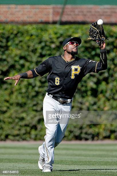 Starling Marte of the Pittsburgh Pirates makes a catch for the last out of their win over the Chicago Cubs at Wrigley Field on September 26 2015 in...