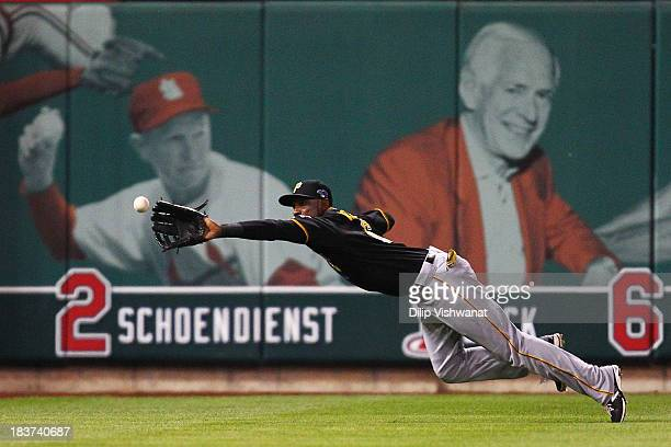 Starling Marte of the Pittsburgh Pirates makes a diving catch for a third inning out against the St Louis Cardinals during Game Five of the National...