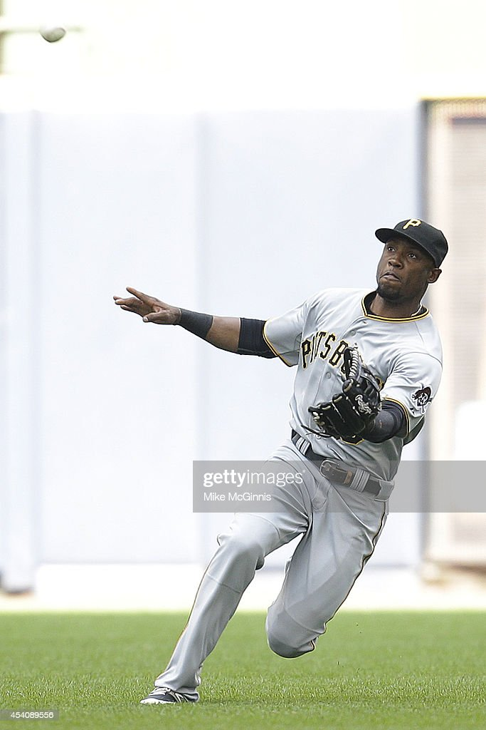 Starling Marte #6 of the Pittsburgh Pirates misses a catch in centerfield allowing Aramis Ramirez a single on an error during the bottom of the sixth inning against the Milwaukee Brewers at Miller Park on August 24, 2014 in Milwaukee, Wisconsin.