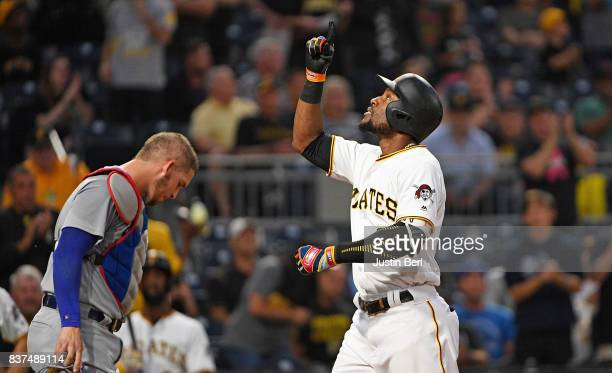 Starling Marte of the Pittsburgh Pirates points towards the sky as he crosses home plate after hitting a two run home run in the third inning during...