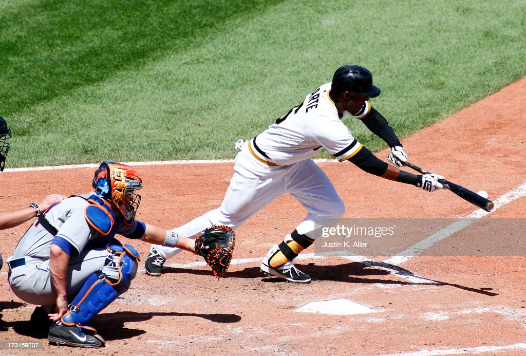 Starling Marte #6 of the Pittsburgh Pirates reaches on a bunt single to third in the fifth inning against the New York Mets during the game on July 14, 2013 at PNC Park in Pittsburgh, Pennsylvania. The Mets won 4-3.