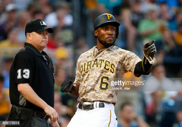 Starling Marte of the Pittsburgh Pirates reacts after scoring on a RBI single in the third inning against the Cincinnati Reds at PNC Park on August 3...