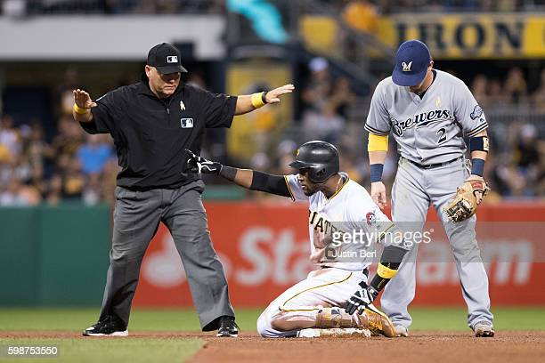 Starling Marte of the Pittsburgh Pirates reacts after sliding in safely with a double in the fourth inning during the game against the Milwaukee...