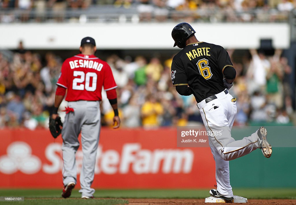 <a gi-track='captionPersonalityLinkClicked' href=/galleries/search?phrase=Starling+Marte&family=editorial&specificpeople=7934200 ng-click='$event.stopPropagation()'>Starling Marte</a> #6 of the Pittsburgh Pirates rounds second after hitting a two run home run in the third inning against the Washington Nationals during the game on May 4, 2013 at PNC Park in Pittsburgh, Pennsylvania.