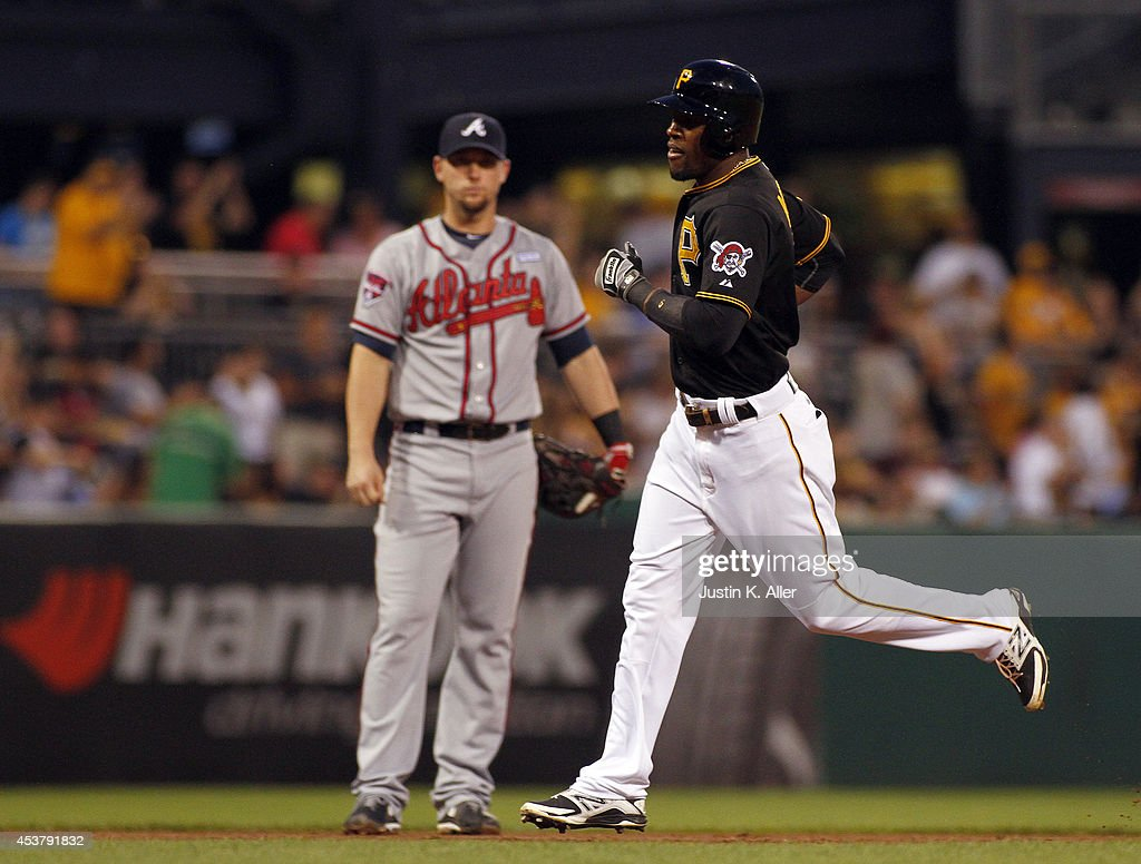 <a gi-track='captionPersonalityLinkClicked' href=/galleries/search?phrase=Starling+Marte&family=editorial&specificpeople=7934200 ng-click='$event.stopPropagation()'>Starling Marte</a> #6 of the Pittsburgh Pirates rounds third after hitting a home run in the fourth inning against the Atlanta Braves during the game at PNC Park on August 18, 2014 in Pittsburgh, Pennsylvania.