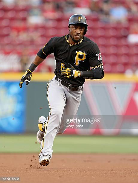 Starling Marte of the Pittsburgh Pirates runs to third base after hitting a double and made it to third base on an error in the first inning during...