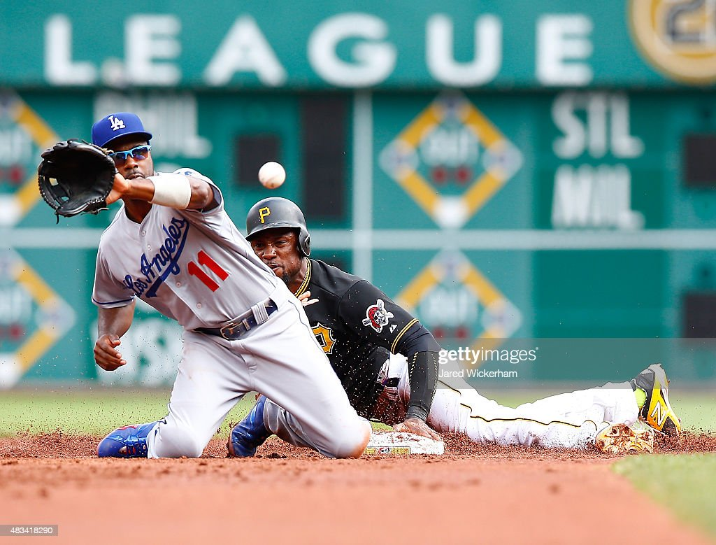 Starling Marte #6 of the Pittsburgh Pirates safely steals second base in front of Jimmy Rollins #11 of the Los Angles Dodgers in the first inning during the game at PNC Park on August 8, 2015 in Pittsburgh, Pennsylvania.
