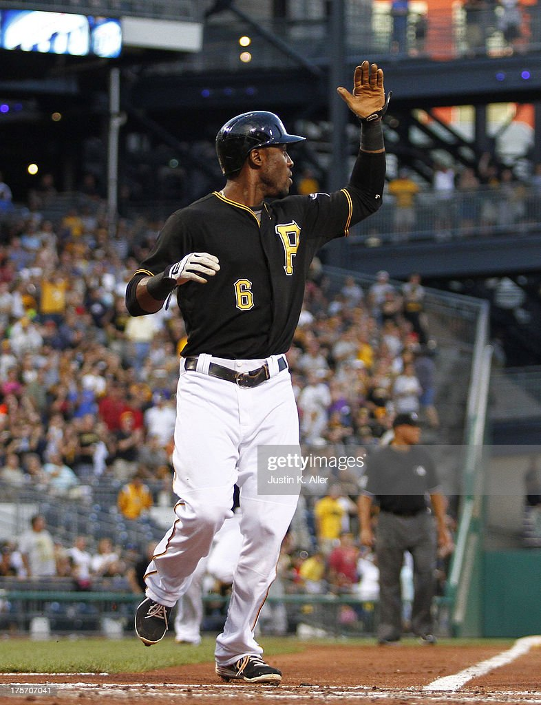 <a gi-track='captionPersonalityLinkClicked' href=/galleries/search?phrase=Starling+Marte&family=editorial&specificpeople=7934200 ng-click='$event.stopPropagation()'>Starling Marte</a> #6 of the Pittsburgh Pirates scores on a two RBI double in the third inning against the Miami Marlins during the game on August 6, 2013 at PNC Park in Pittsburgh, Pennsylvania.