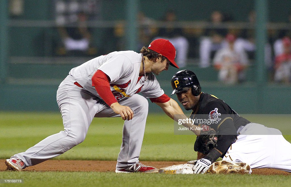 <a gi-track='captionPersonalityLinkClicked' href=/galleries/search?phrase=Starling+Marte&family=editorial&specificpeople=7934200 ng-click='$event.stopPropagation()'>Starling Marte</a> #6 of the Pittsburgh Pirates slides in safe at second in the fifth inning against <a gi-track='captionPersonalityLinkClicked' href=/galleries/search?phrase=Pete+Kozma&family=editorial&specificpeople=6800748 ng-click='$event.stopPropagation()'>Pete Kozma</a> #38 of the St. Louis Cardinals during the game on July 31, 2013 at PNC Park in Pittsburgh, Pennsylvania.