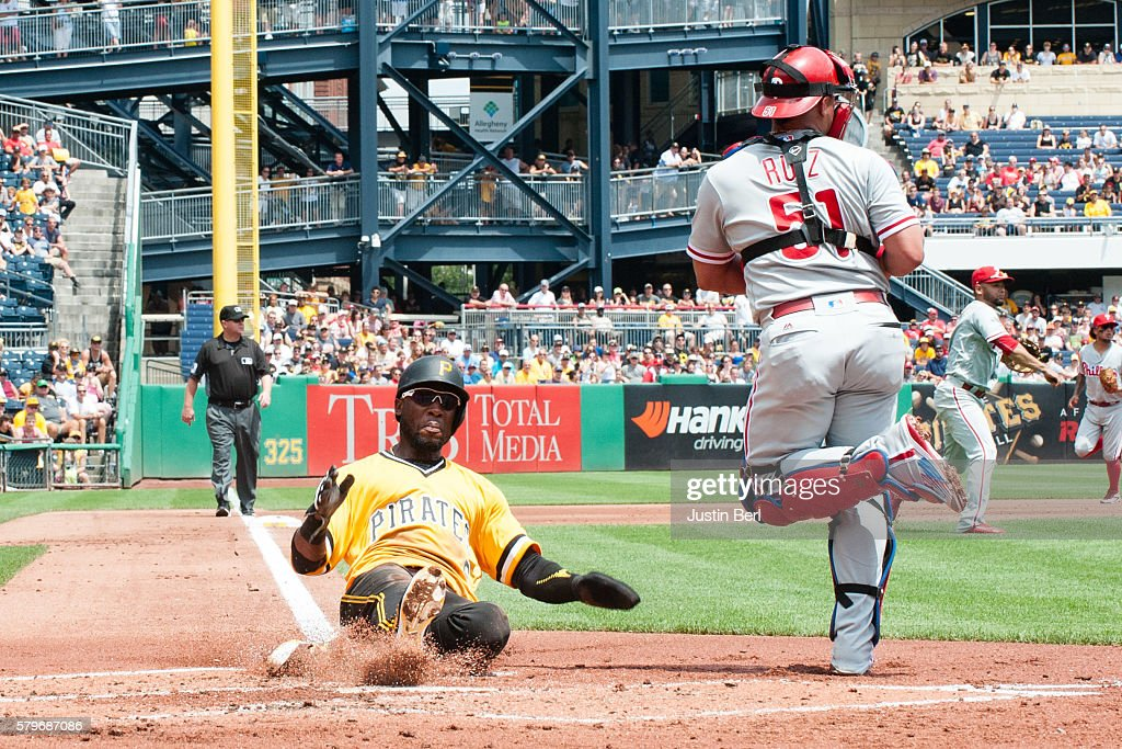 Starling Marte 6 Of The Pittsburgh Pirates Slides Safely Into Home Plate Past Carlos Ruiz