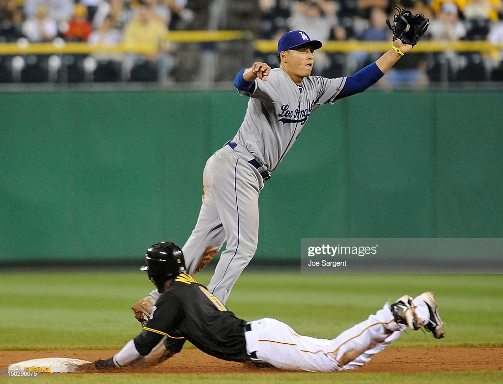 <a gi-track='captionPersonalityLinkClicked' href=/galleries/search?phrase=Starling+Marte&family=editorial&specificpeople=7934200 ng-click='$event.stopPropagation()'>Starling Marte</a> #6 of the Pittsburgh Pirates slides safely into second base in front of <a gi-track='captionPersonalityLinkClicked' href=/galleries/search?phrase=Hanley+Ramirez&family=editorial&specificpeople=538406 ng-click='$event.stopPropagation()'>Hanley Ramirez</a> #13 of the Los Angeles Dodgers on August 14, 2012 at PNC Park in Pittsburgh, Pennsylvania. Los Angeles won the game 11-0.