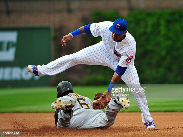 Starling Marte of the Pittsburgh Pirates steals second base as Addison Russell of the Chicago Cubs tries to tag him out during the fourth inning on...