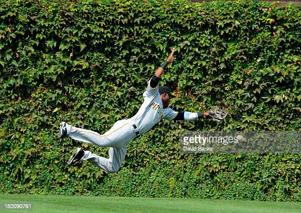 Starling Marte of the Pittsburgh Pirates tries to make a diving catch on a Anthony Rizzo of the Chicago Cubs double in the first inning on September...