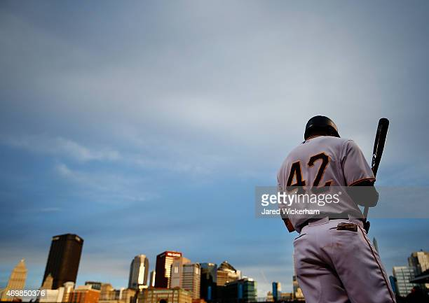 Starling Marte of the Pittsburgh Pirates warms up in the on deck circle in the second inning against the Detroit Tigers while wearing the to...