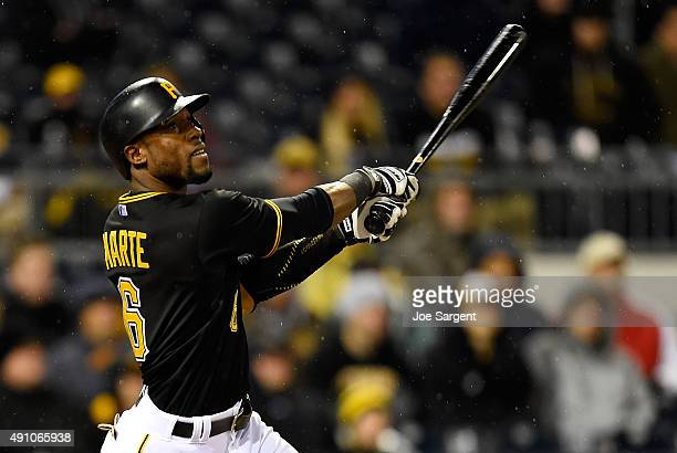 Starling Marte of the Pittsburgh Pirates watches his two run home run in the twelfth inning to beat the Cincinnati Reds 64 on October 2 2015 at PNC...
