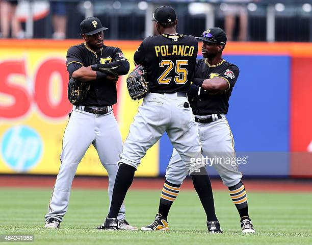 Starling MarteGregory Polanco and Andrew McCutchen of the Pittsburgh Pirates celebrate the win over the New York Mets on August 16 2015 at Citi Field...