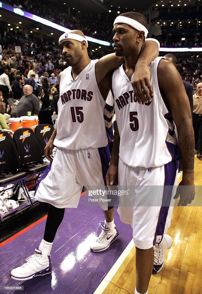 Jalen Rose, right, gets a hug from teammate Vince Carter at the end of the NBA Toronto Raptors 101-94 loss to the Seattle Supersonics at the ACC in Toronto on Friday night. Rumours abound that Vince Carter and Jalen Rose are to be involved in a trade with Portland.(Photo by Peter Power/The Toronto Star)pmp