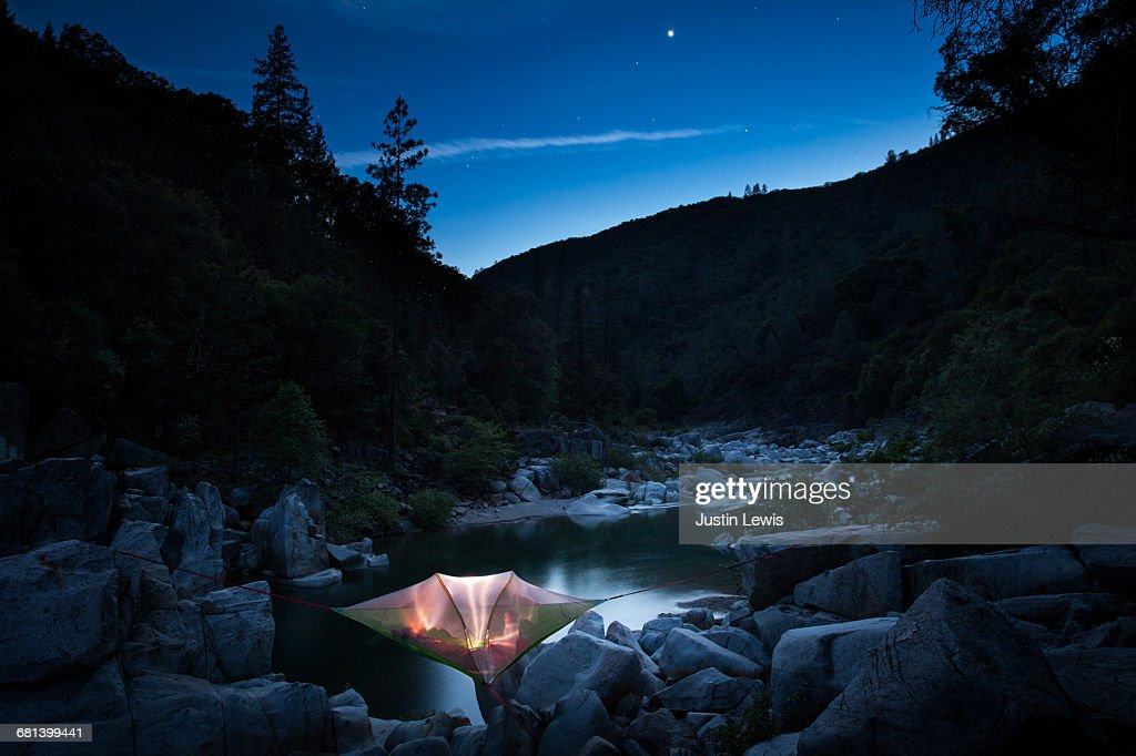 Starry Night, Camper in Tree Tent Above River : Stock Photo