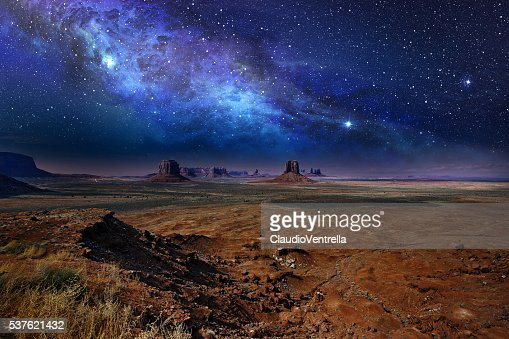 starry night sky in monument valley : Stock Photo