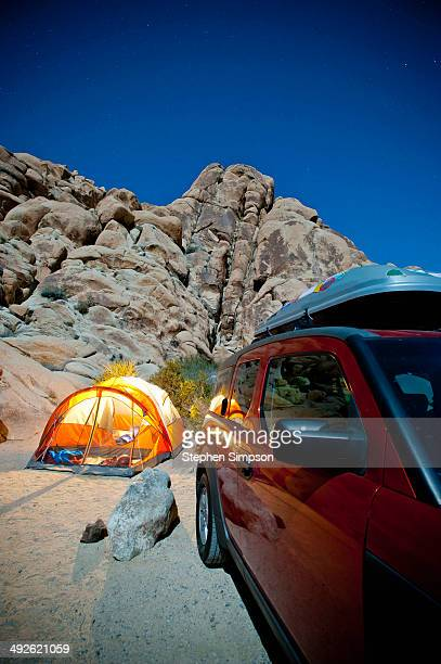 starry night view of campsite, tent and car