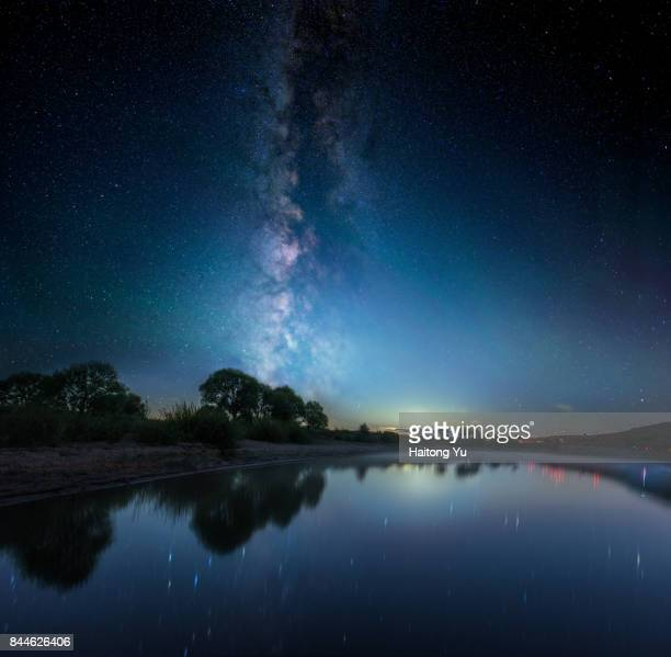 Starry sky reflected in a pond
