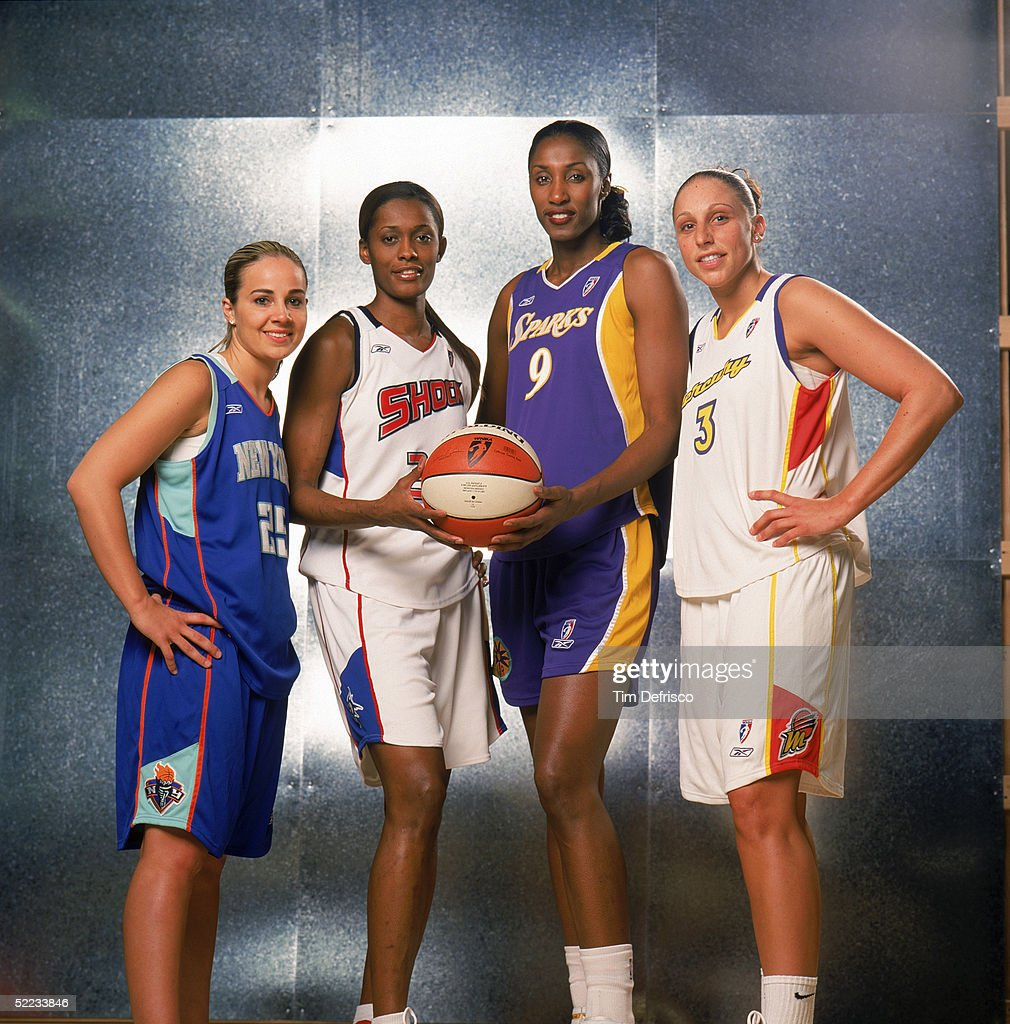 WNBA stars (L-R) Becky Hammon of the New York Liberty, Swin Cash of the Detroit Schock, Lisa Leslie #9 of the Los Angeles Sparks and Diana Taurasi of the Phoenix Mercury pose for a portrait prior to competing in the RadioShack Shooting Stars Competition during 2005 NBA All-Star Weekend at Pepsi Center on February 19, 2005 in Denver, Colorado.