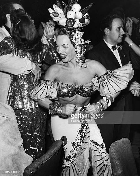 Stars dress up for the Photographers' Ball Carmen Miranda was in good form and wore a splendiferous hat