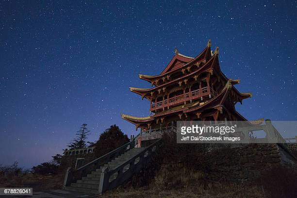 Stars of the Big Dipper and constellation Leo shine above a temple of Mount Emei in China.